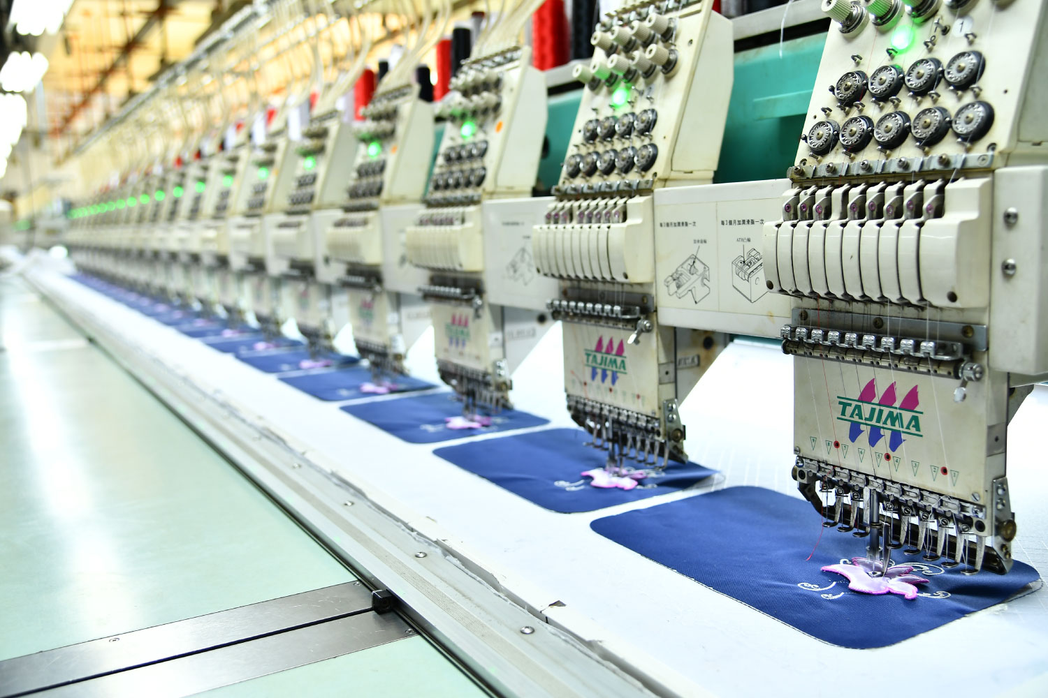 Embroidery machine making part of a bag in Starry factory in China